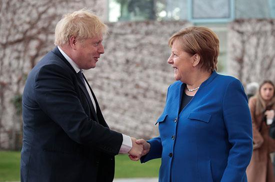 المستشارة الألمانية ورءئيس وزراء بريطانيا