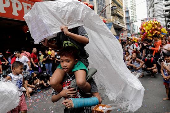 احتفال الاطفال بالسنة القمرية الصينية