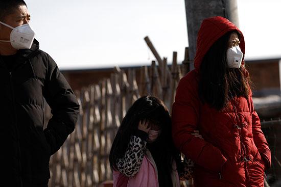 اغلب سكان الصين يرتدون الأقنعة