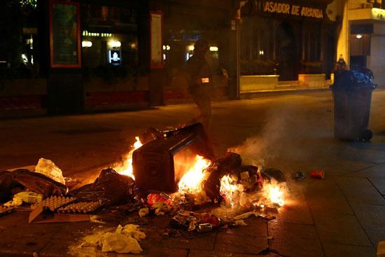 اشتباكات بين الشرطة ومحتجين على قيود كورونا فى عدة مدن إسبانية (3)