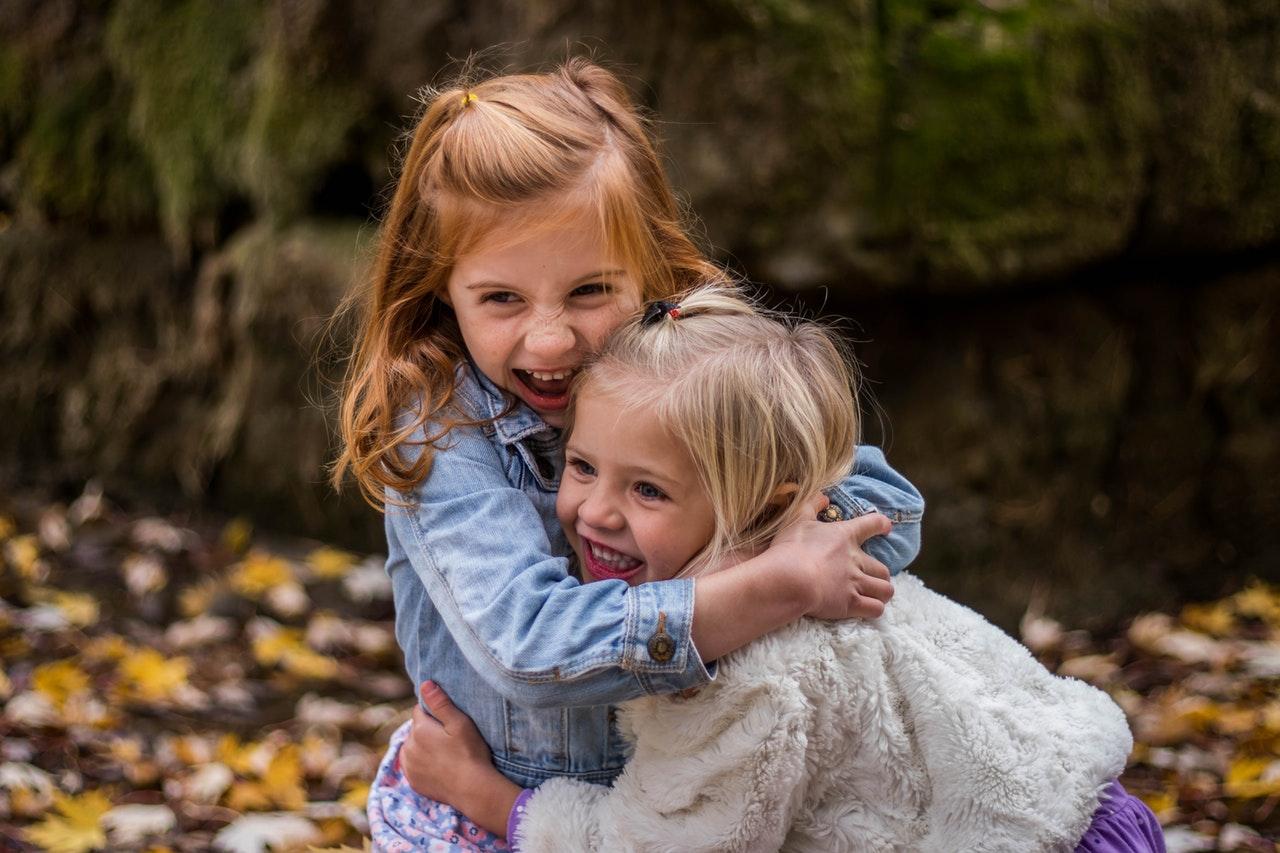 girls-hugging-outdoors-during-playtime-by-Trinity-Kubassek@Pexels