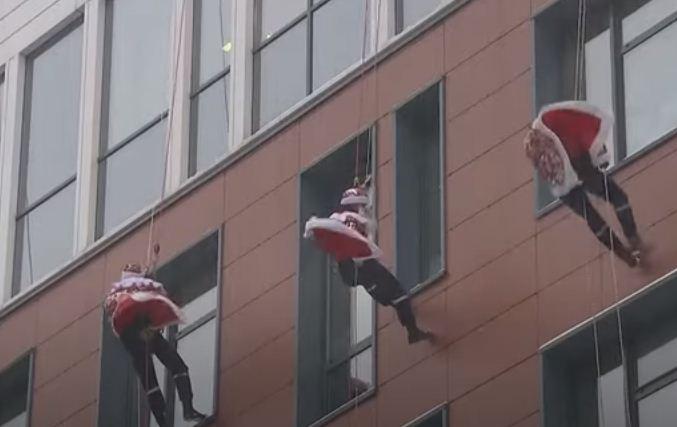 Rescuers in Santa Claus costumes