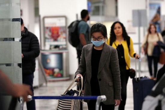 مسافرون عائدون من الصين