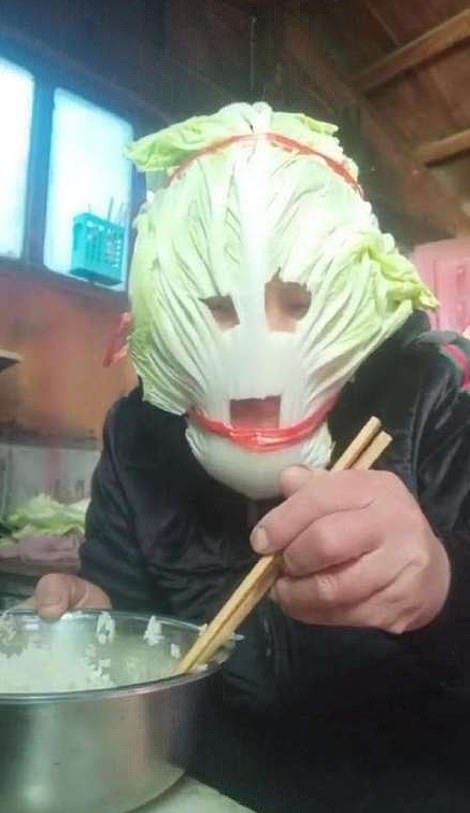 24085574-7947709-A_man_wearing_a_mask_made_of_lettuce-a-104_1580396509925