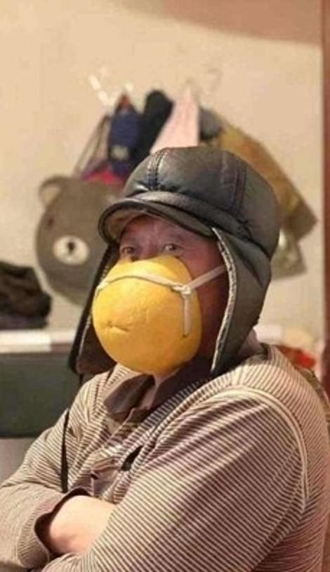 24085434-7947709-A_man_wearing_a_mask_fashioned_out_of_grapefruit_peel-a-103_1580396509913