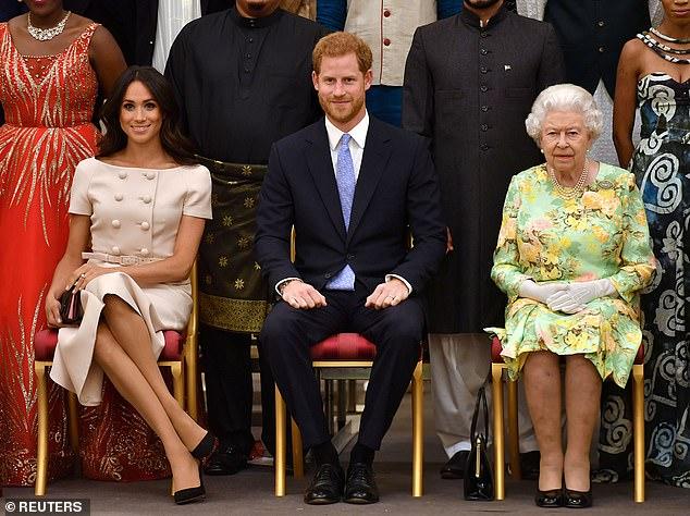 الأمير هارى وميجان ماركل والملكة إليزابيث الثانية