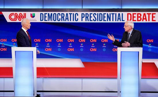 مناظرة ساخنة بلا جمهور بين بايدن وساندرز بالانتخابات الأمريكية