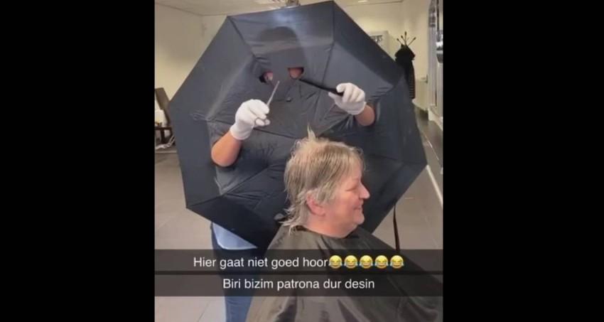 هولندية تحتمى بمظلة لتصفيف شعر الزبائن (1)