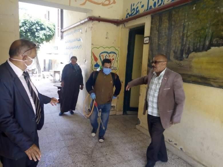 مشاركة المعلمين بتطهير المدارس والمؤسسات ببنى سويف (1)