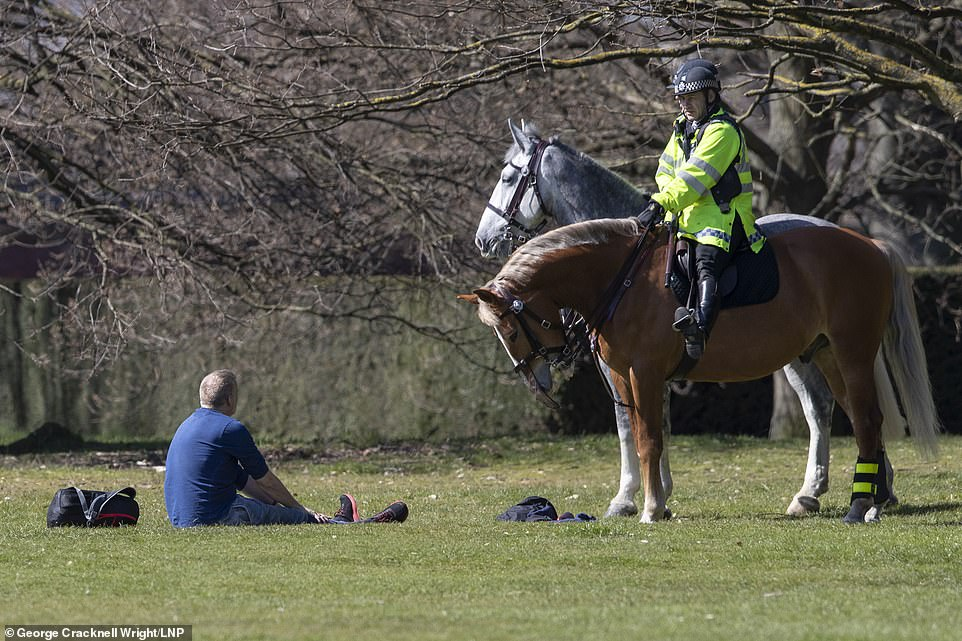 26804686-8186935-Police_on_horseback_advised_this_man_in_Greenwich_Park_in_London-a-75_1586028222641