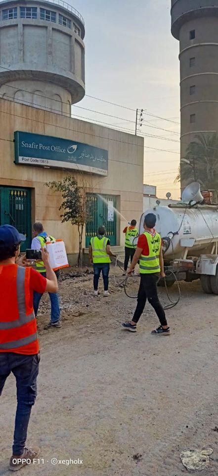 شباب قليوب يطهرون مكاتب البريد بعد انتهاء صرف المعاش