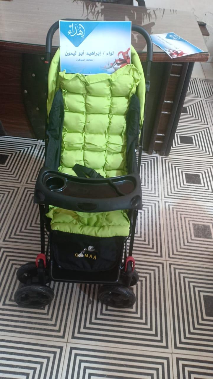 عجلة وكوفرته هدية محافظ المنوفية لأول مولود داخل العزل الصحي بالباجور (1)