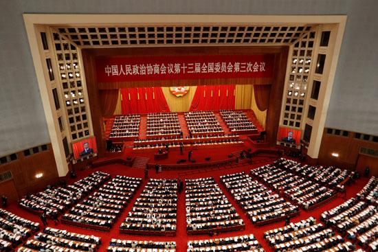 المسئولون والمندوبون الصينيون يحضرون الجلسة الافتتاحية للمؤتمر