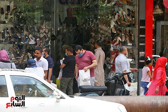 الاقبال على شراء ملابس العيد (1)