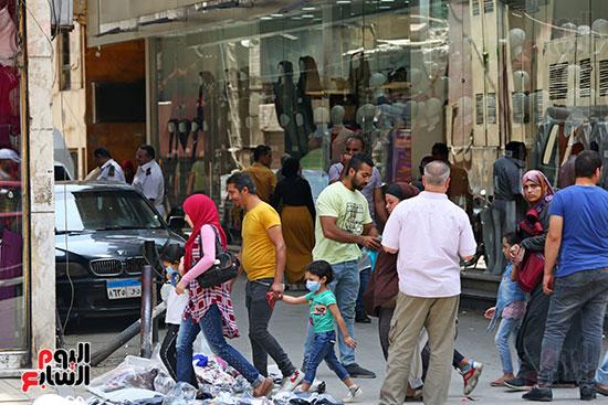الاقبال على شراء ملابس العيد (6)