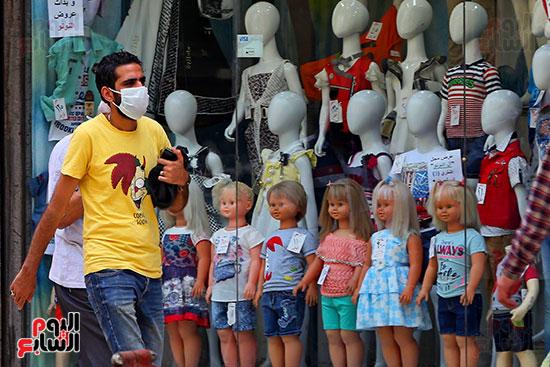 اقبال المواطنيين على شراء ملابس عيد الفطر المبار (4)