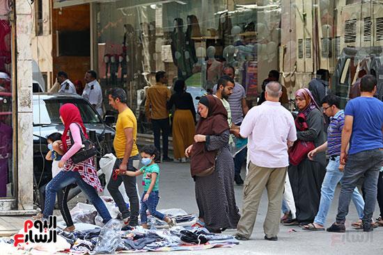 الاقبال على شراء ملابس العيد (7)