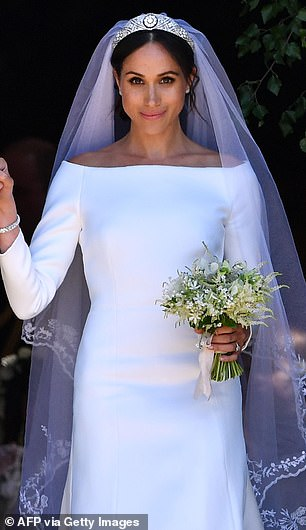 28926586-8364815-Meghan_is_pictured_at_her_wedding_to_Prince_Harry_in_2018-m-4_1590668744251