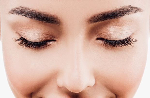 closeup_of_womans_face_eyes_closed_636100670