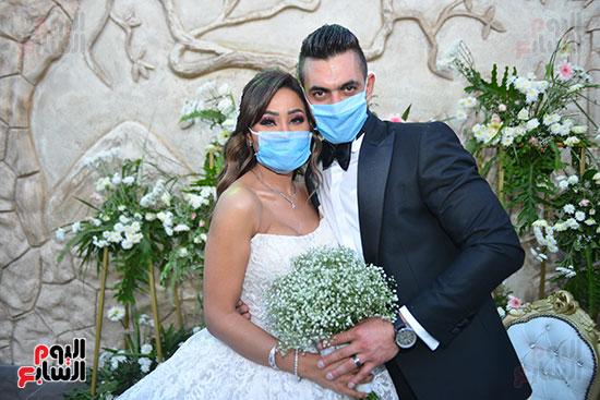 العروسان حسام و إيمان رمضان