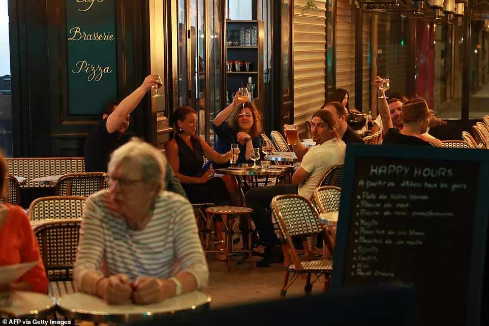 29114932-8379491-Parisians_raise_their_glasses_at_the_Royal_Cambronne_brasserie_i-a-18_1591096943630