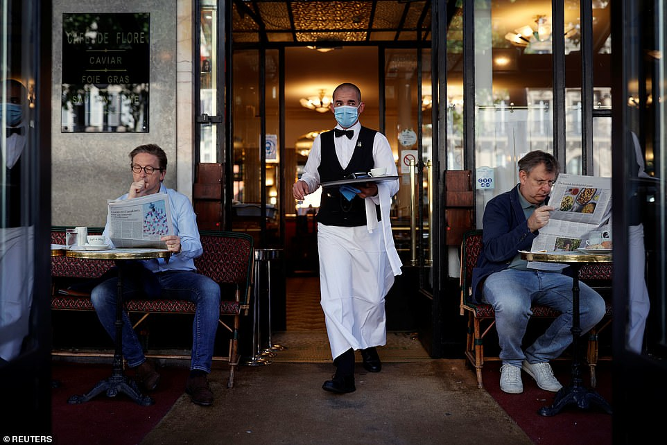 29115834-8379491-A_waiter_wearing_a_face_mask_serves_at_Cafe_de_Flore_as_restaura-a-25_1591096943652