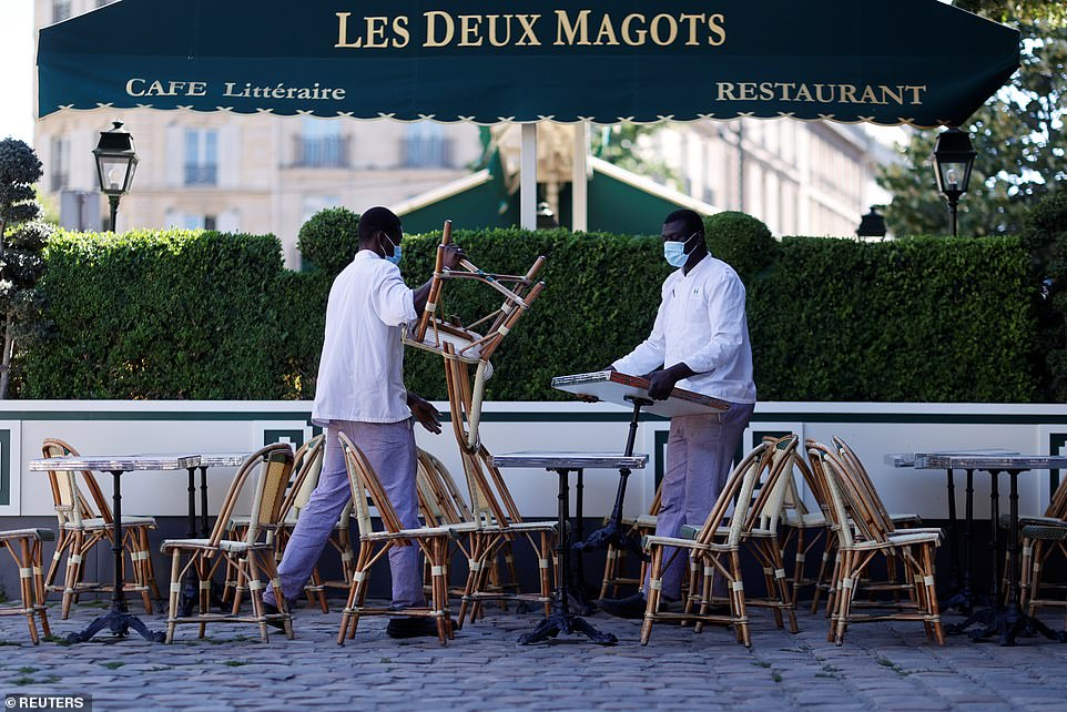 29115950-8379491-Staff_members_of_cafe_and_restaurant_Les_Deux_Magots_in_Paris_in-a-22_1591096943640