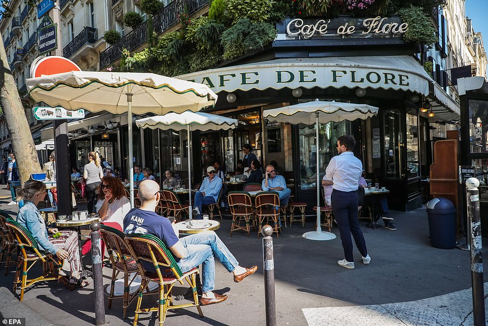 29120960-8379491-People_at_the_terrace_of_Cafe_de_Flore_in_the_Latin_Quarter_dist-a-30_1591096943700