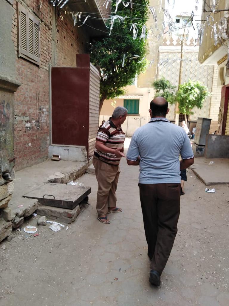 توزيع الكمامات على مواطني حي الغمراوى