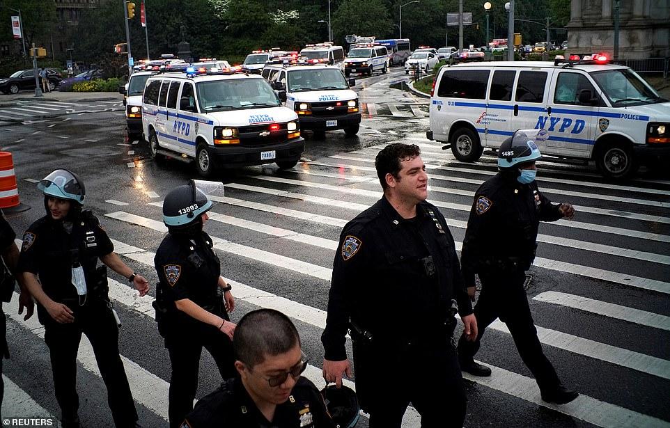 29284800-8393847-NEW_YORK_CITY_Dozens_of_cops_were_seen_walking_alongside_with_pr-a-14_1591416764855