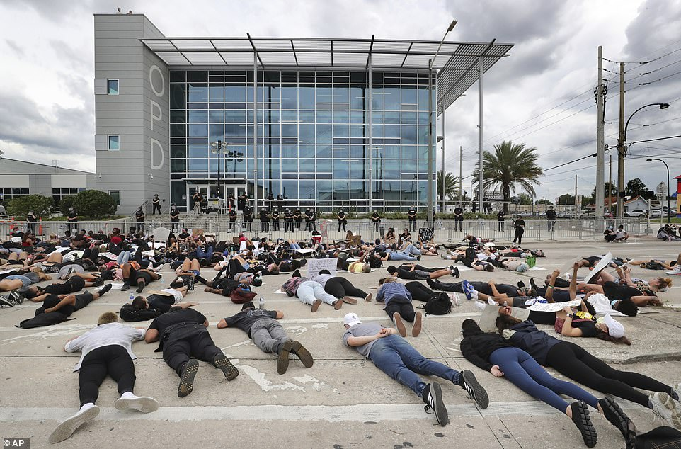 29284198-8393847-ORLANDO_FLORIDA_Protesters_lie_down_in_front_of_the_Orlando_Poli-a-10_1591416764826