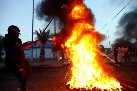 2020-07-27T084620Z_620224019_RC2K1I9L8IDR_RTRMADP_3_IRAQ-PROTESTS