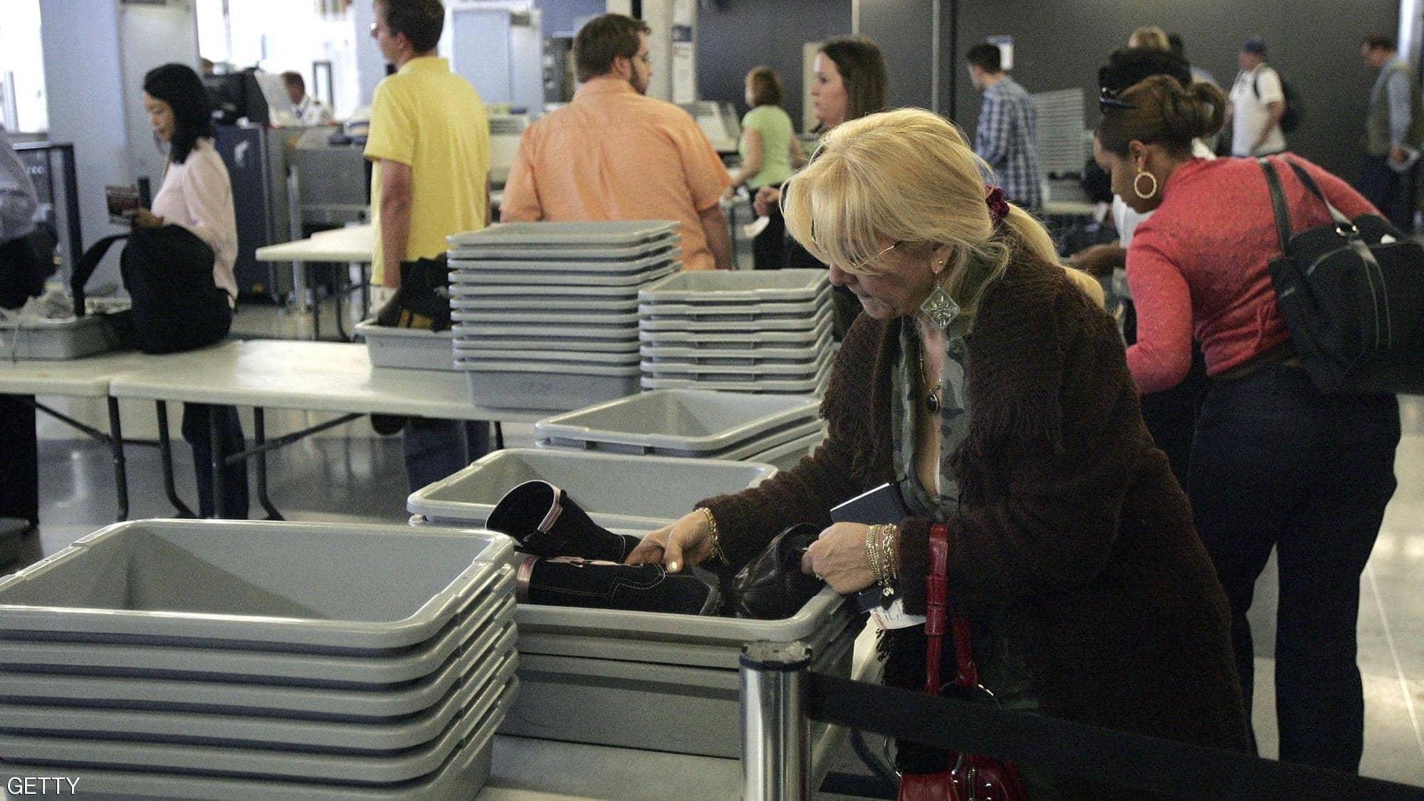 مسافرون فى مطار أمريكى