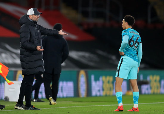 Klopp gives his instructions to the player, Arnold