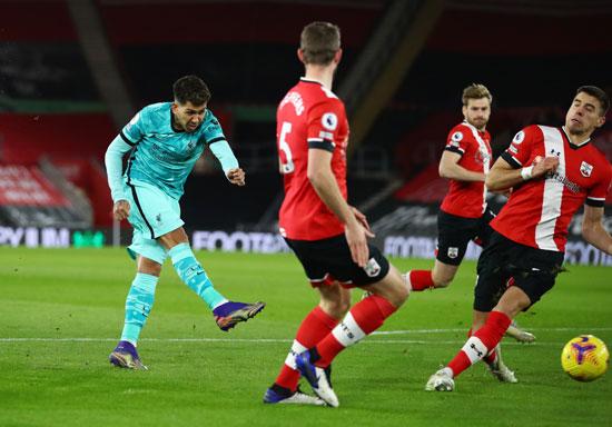 Firmino-striker-Liverpool-strikes-the ball