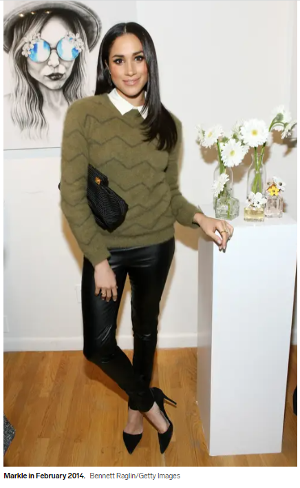Megan in a wool blouse and leather pants