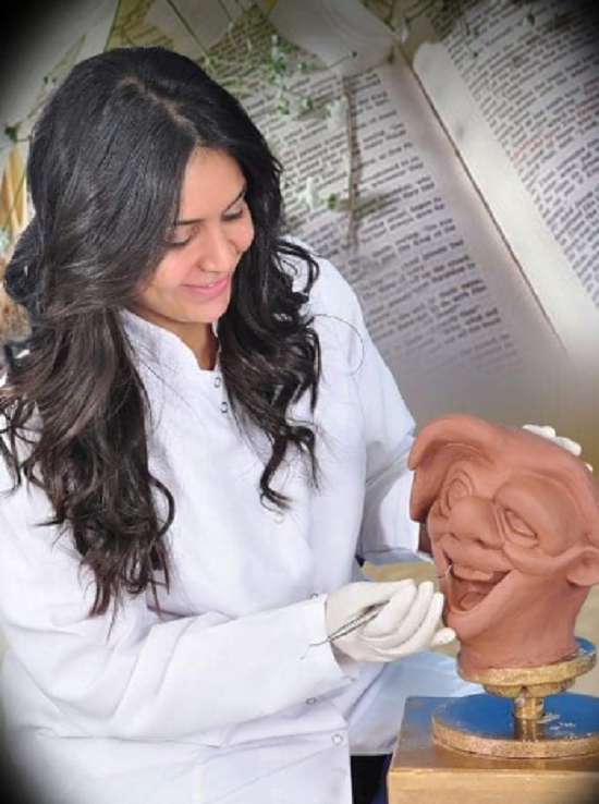 Mary while sculpting a statue