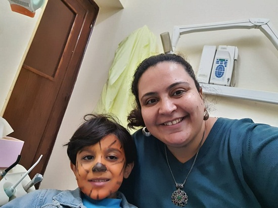 Mary with a child inside the clinic