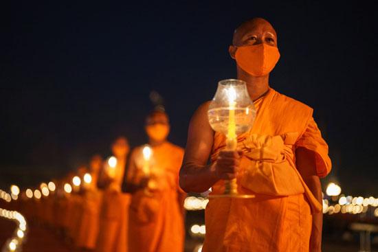 2021-02-26T170734Z_715784700_RC2H0M9P6ASP_RTRMADP_3_HEALTH-CORONAVIRUS-THAILAND-RELIGION