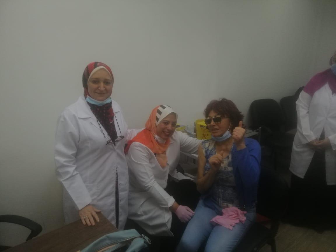 Nabila Obaid receives the vaccine