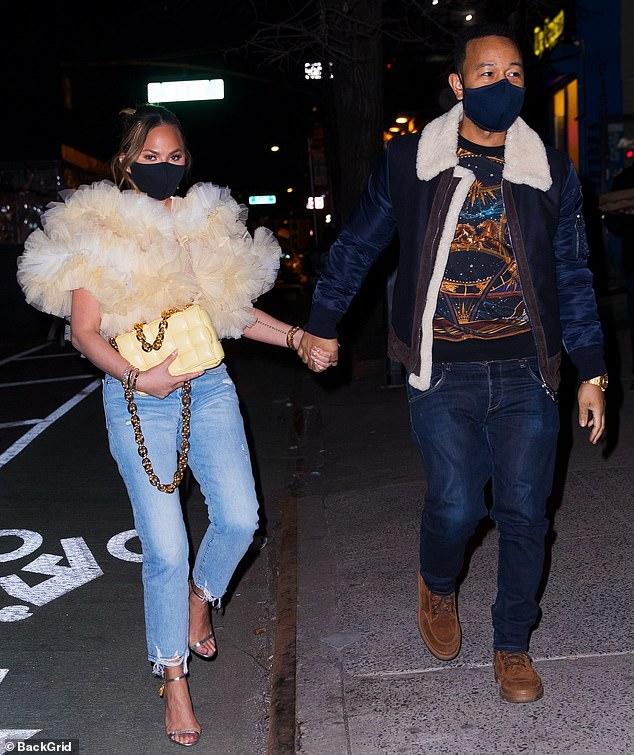 كريسي تيجن مع زوجها
