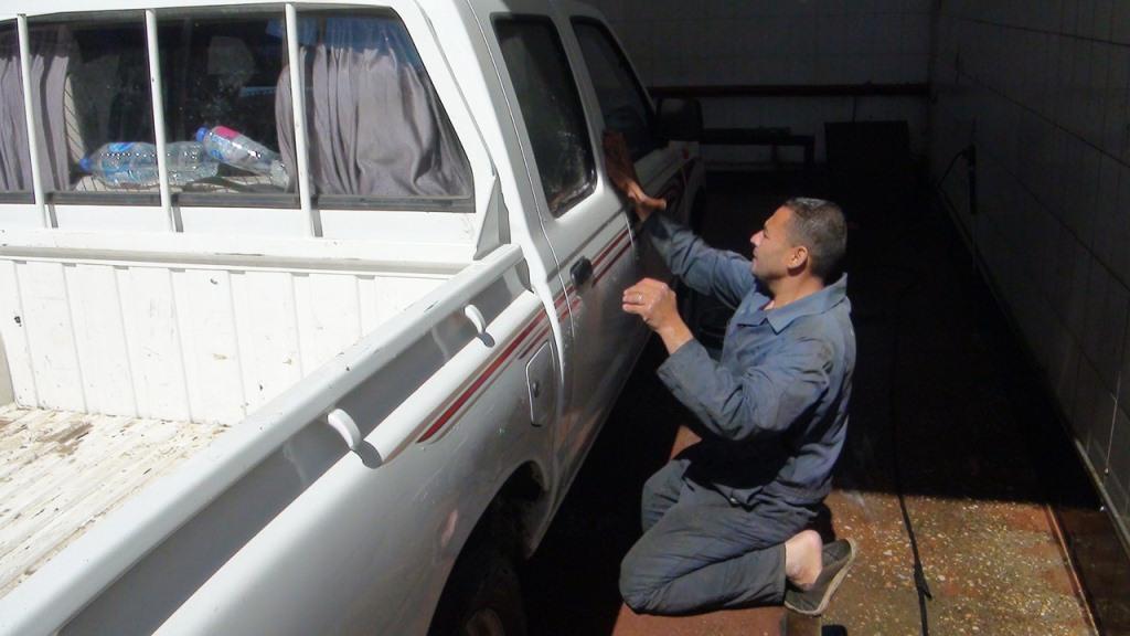 مهنة رش وتنظيف السيارات