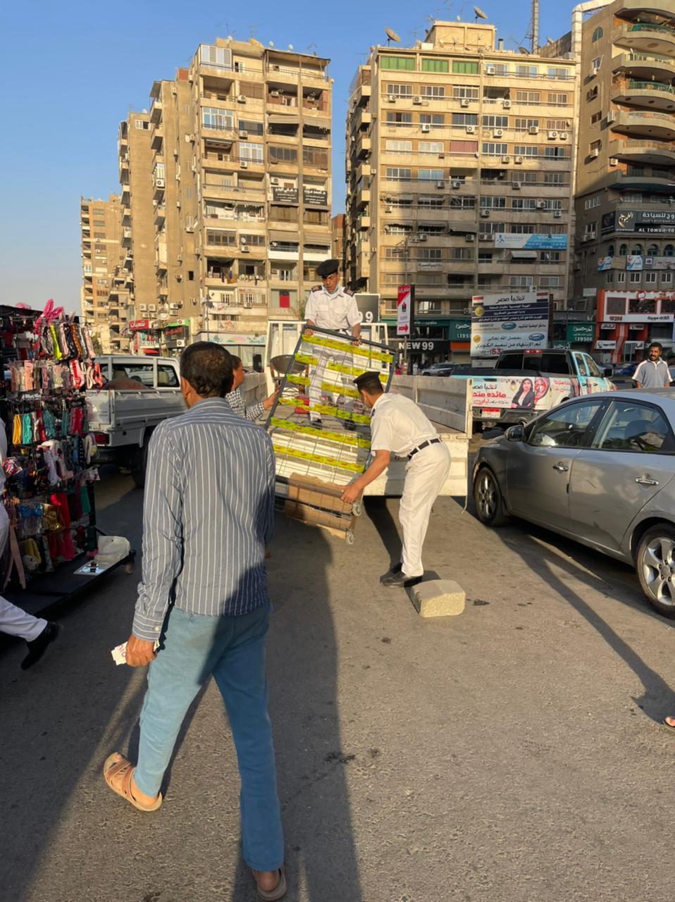 حملة لحى مدينة نصر لإزالة الاشغالات بشارع عباس العقاد