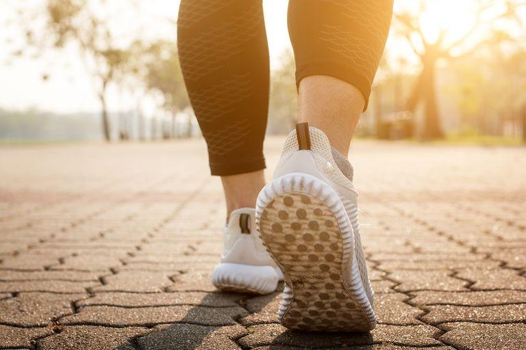runner-feet-running-on-road-closeup-on-shoe-royalty-free-image-918789438-1553023708