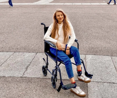 The girl's companion in the wheelchair