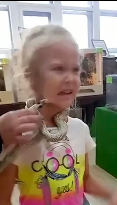 Snake bites a girl