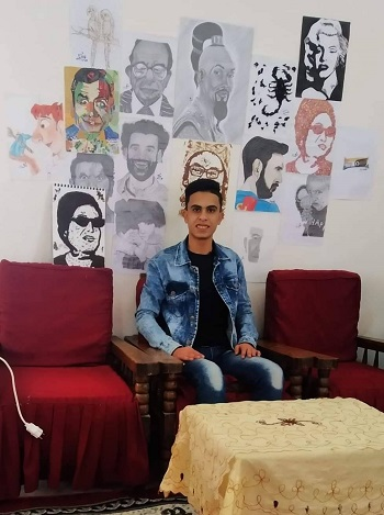 Ibrahim with his paintings