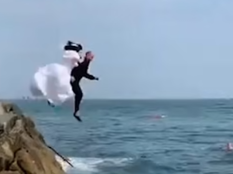 The newlyweds jumped