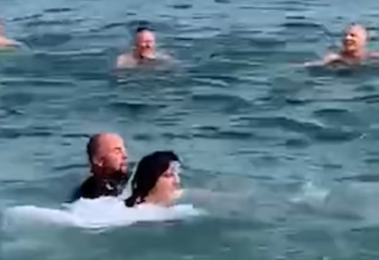 The newlyweds in the water