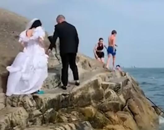 The newlyweds climb the rock